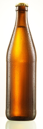 dewed: bottle of beer with drops isolated