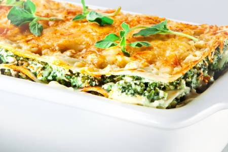 Italian cuisine. Spinach lasagna with basil. Macro photo