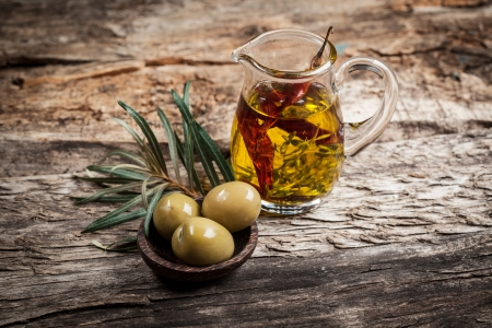 chilly: Green olives and olive oil with spice Stock Photo