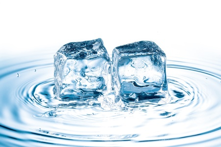 ice cubes falling on water surface photo