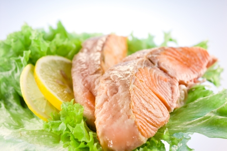 salmon  fillet with salad and lemon photo