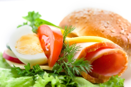 cold cuts: sandwich with ham,cheese, fresh vegetables and egg Stock Photo