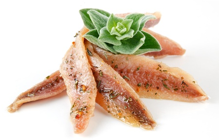 marinate: anchovies on white with spice and oregano