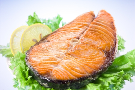 salmon steak with salad and lemon photo