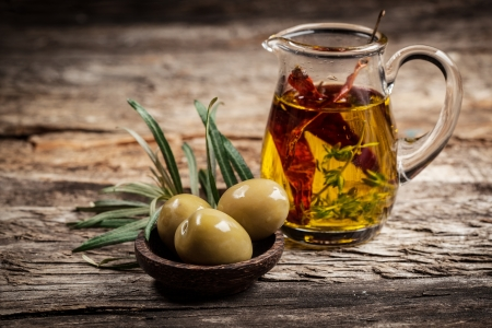 extra virgin olive oil: Green olives and olive oil with spice Stock Photo