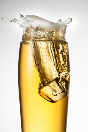 Beer with ice  Splash with drops and foam photo