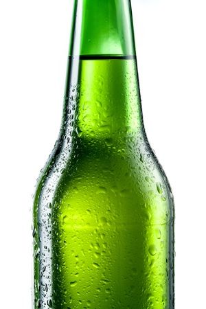 dewed: Green bottle of beer with drops