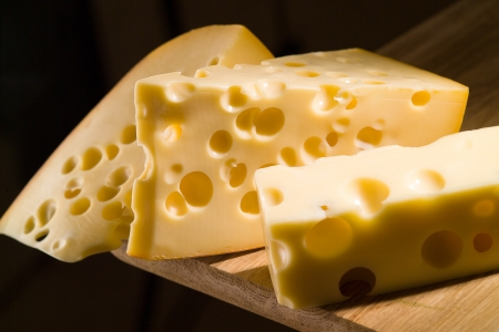 cheddar: Cheese on wooden board