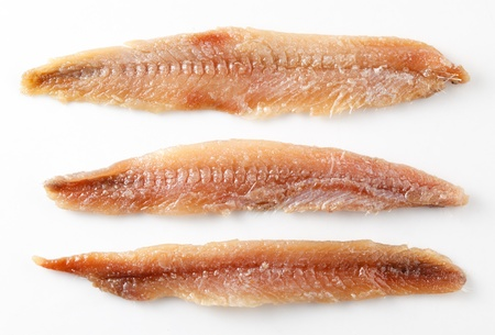 Anchovy  fillet isolated on white photo