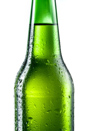 dewed: Bottle of beer with drops isolated on white