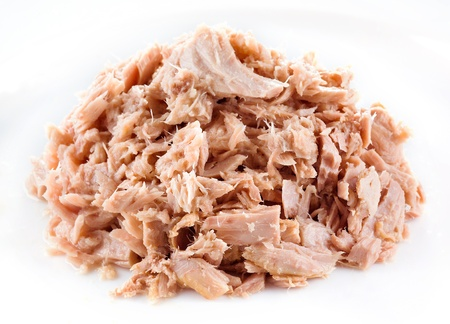 Tuna  canned fish on white photo