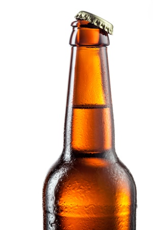 dew cap: Open bottle of beer with drops isolated on white