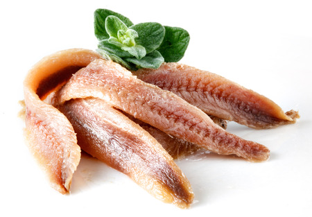 antipasto: anchovies on white with oregano Stock Photo