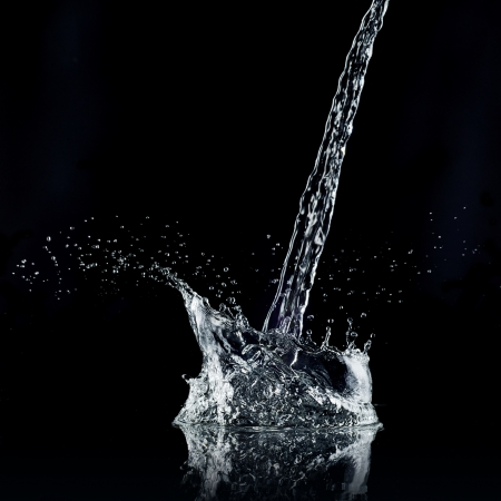 Water splash isolated on black background  High resolution