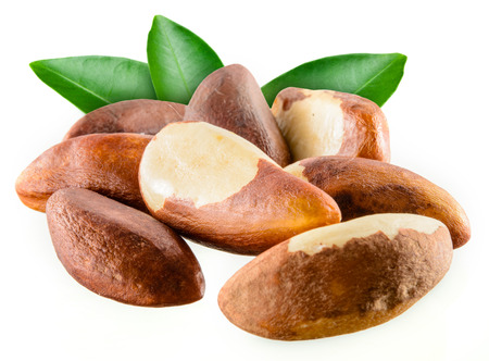 Brazil nuts with leafs isolated on white  Stock Photo