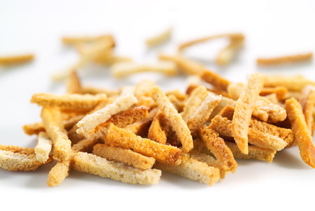 Many small salty dried rusks on white photo