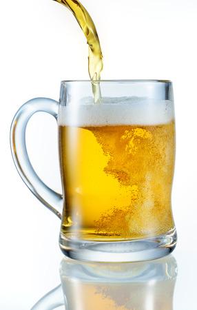 Beer pouring into mug photo