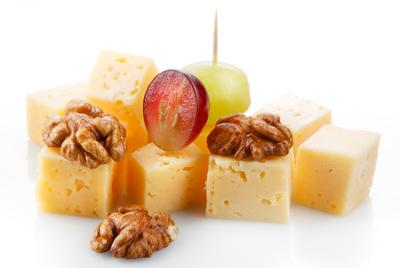Canape with cheese, grape, olive and nuts. Macro