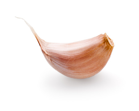 garlic clove: Garlic clove isolated on white
