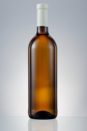 Dark brown glass bottle with white wine isolated photo