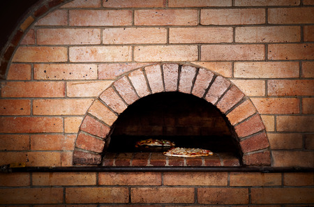pizza oven: A traditional oven for cooking and baking pizza