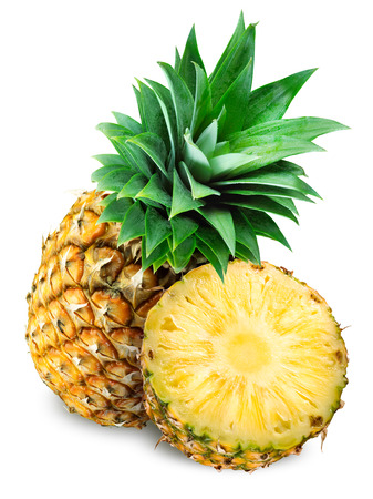 Pineapple with slice isolated on white photo