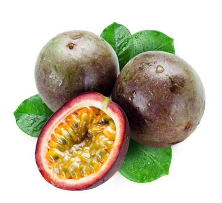 Wet passion fruits with leaves isolated on white photo