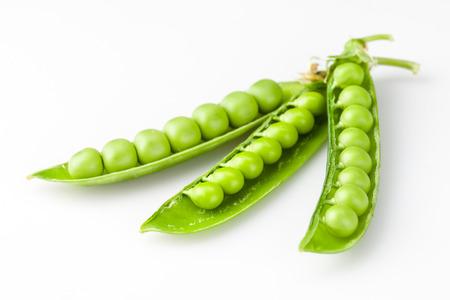 Fresh peas isolated on white background photo
