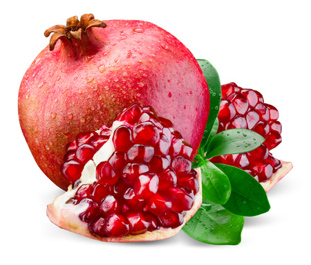 Juicy pomegranate and its piece with leaves. Isolated on a white background.