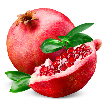 Ripe pomegranate with leaves isolated on a white background Stock Photo