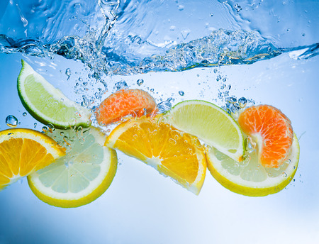 deeply: Tropical fruits fall deeply under water with a big splash