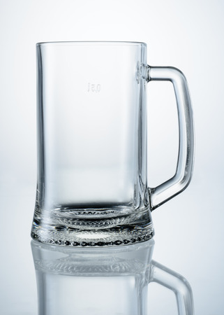 Empty beer mug with reflection isolated. With clipping path photo