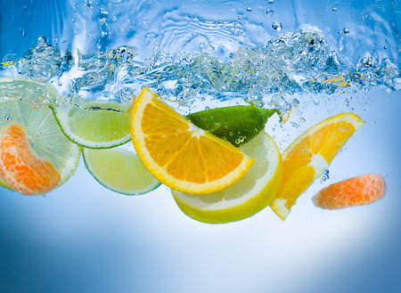 orange peel skin: Fresh fruit slices under water Stock Photo