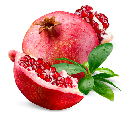 Ripe wet pomegranate with piece and leaves isolated on a white Imagens