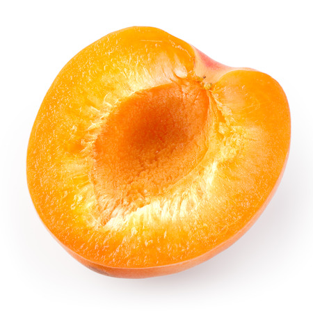 apricot kernel: Apricot. Half isolated on a white background. Stock Photo