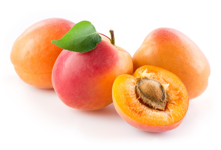 apricot kernel: Apricots isolated on white background Stock Photo