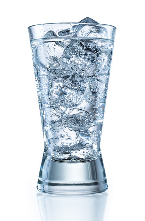 carbonated: Glass of mineral carbonated water with ice.