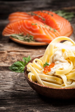 sause: noodles with sause and caviar. Organic food Stock Photo
