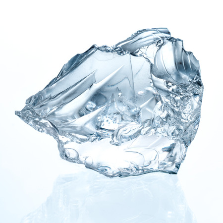 ice water: Ice cube isolated on white.