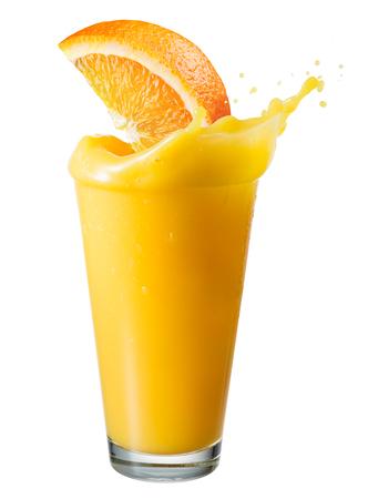 fruit orange: Zumo de naranja con el chapoteo y la rebanada de la fruta aislado en blanco Foto de archivo