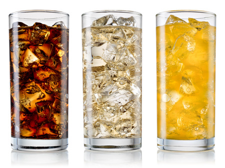 fizzy: Glass of cola, fanta, sprite with ice cubes isolated on white. With clipping path