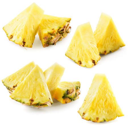 Fresh cut pineapple. Pieces isolated on white background. Collection