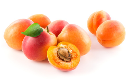 apricot kernels: Apricot. Fruits with leaf isolated on white background