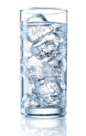 water reflection: Glass of mineral carbonated water with ice