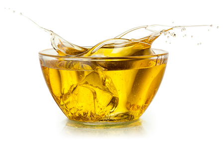 pouring: Cooking oil. Splash isolated on white. With clipping path.