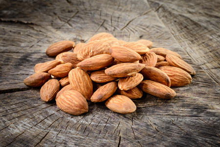 almond: Almonds on wooden background