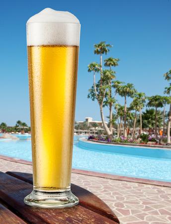 drinks on bar: Mug of light beer outdoor. Summer