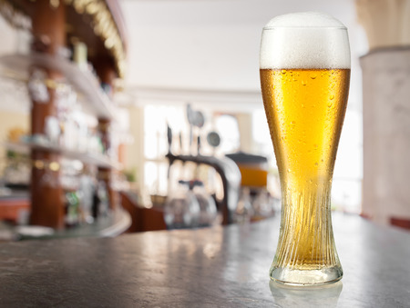 unbottled: Glass of light beer in a pub.