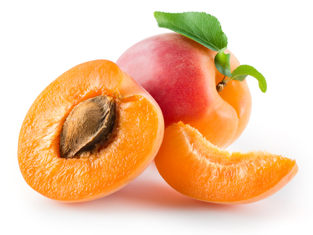 apricot kernel: Apricot, half and piece isolated on white background