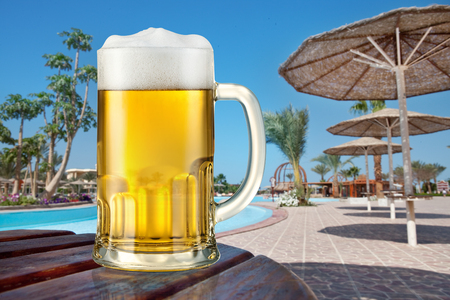pool bar: Mug of light beer outdoor. Summer